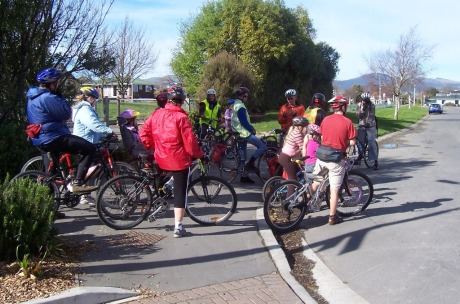 Participants on a Spokes Ride hear about plans for the city