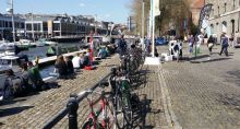 People (and bikes) share the waterfront. Not fun to ride on those cobbles though...