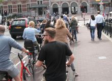 Unfortunately encouragement of cycling doesn't prevent the endless queues...