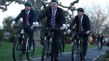 Prime Minister John Key leads Transport Minister Simon Bridges and local MP Todd McClay for a spin around Rotorua (that's not a footpath is it chaps?) [c/ Benn Bathgate, Fairfax]